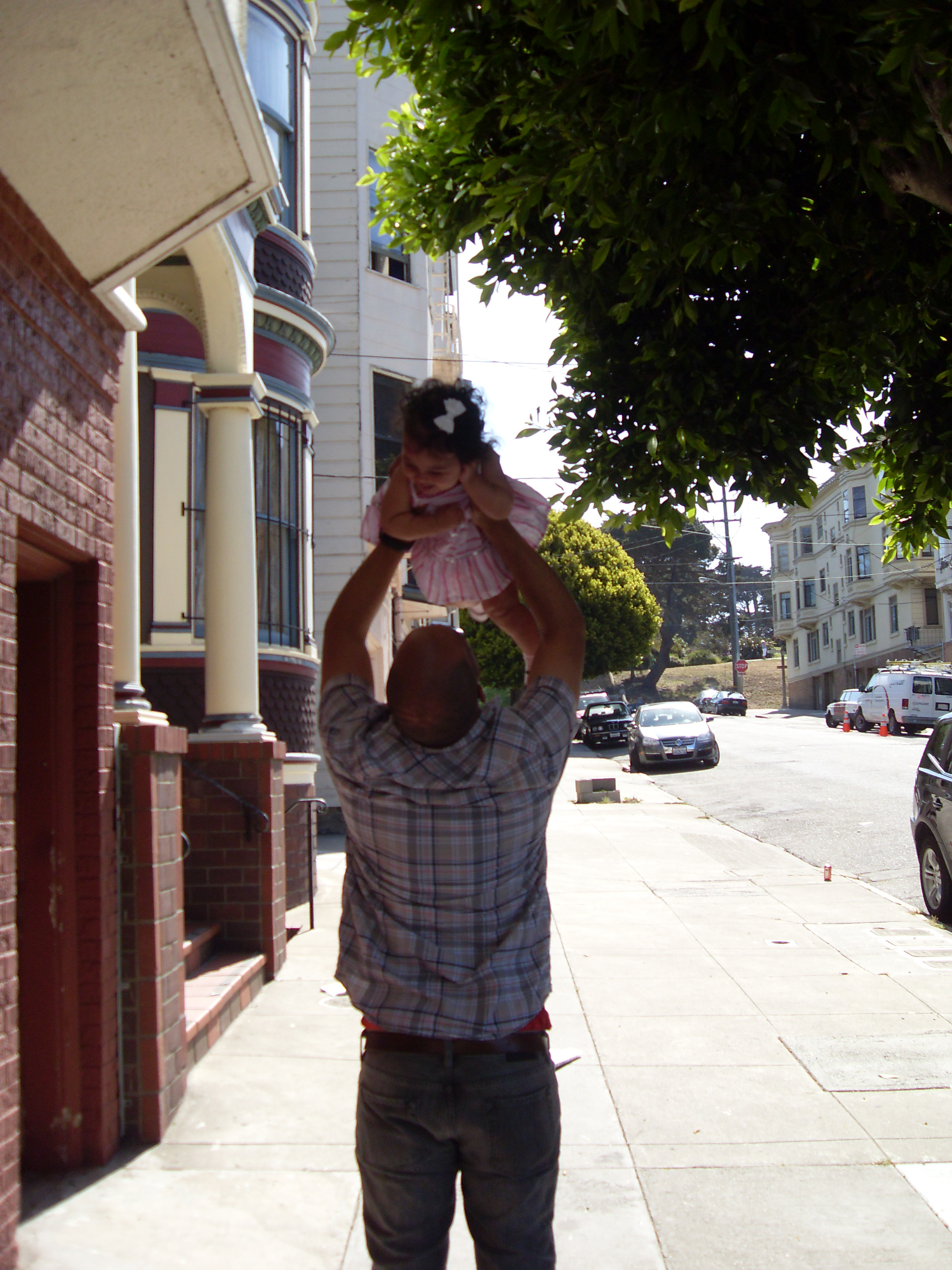 Dad holding baby overhead