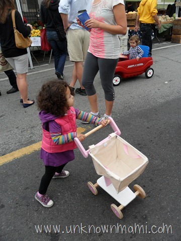 Little girl with canvas shopping cart