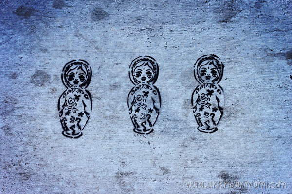 Russian nesting dolls stenciled on the sidewalk.