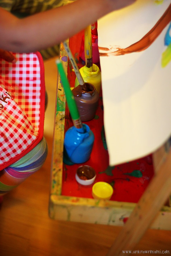 Child painting on easel