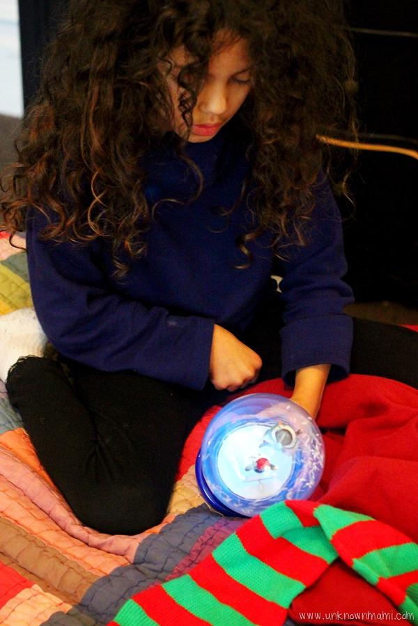 Looking at a snow globe