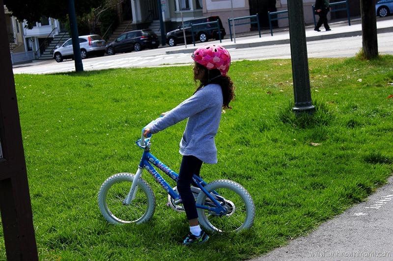 Little girl riding bike in San Francisco